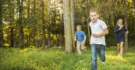 Kids running through the forest